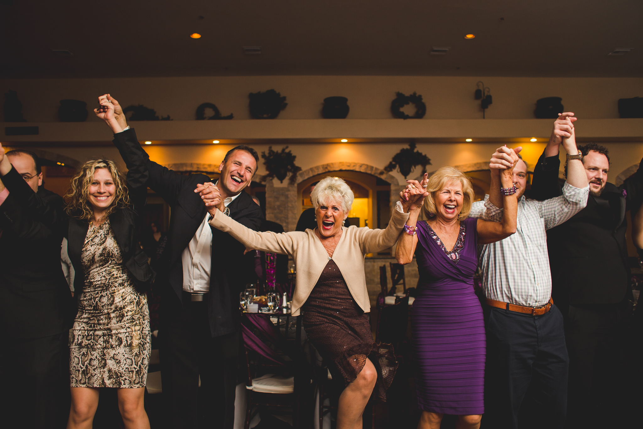 people having tons of fun at wedding reception mj aaron kes photography