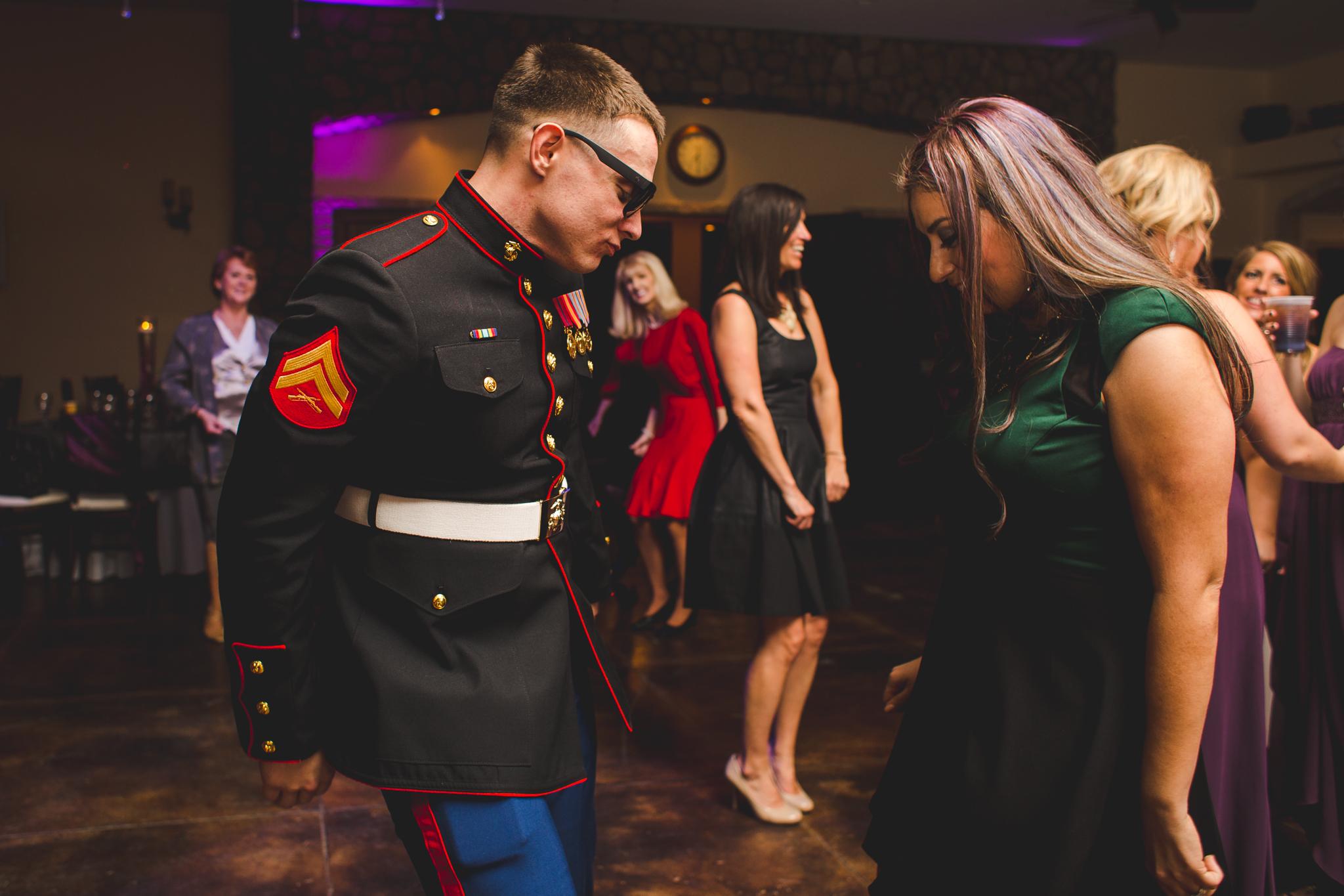 brother dances on floor at wedding mj