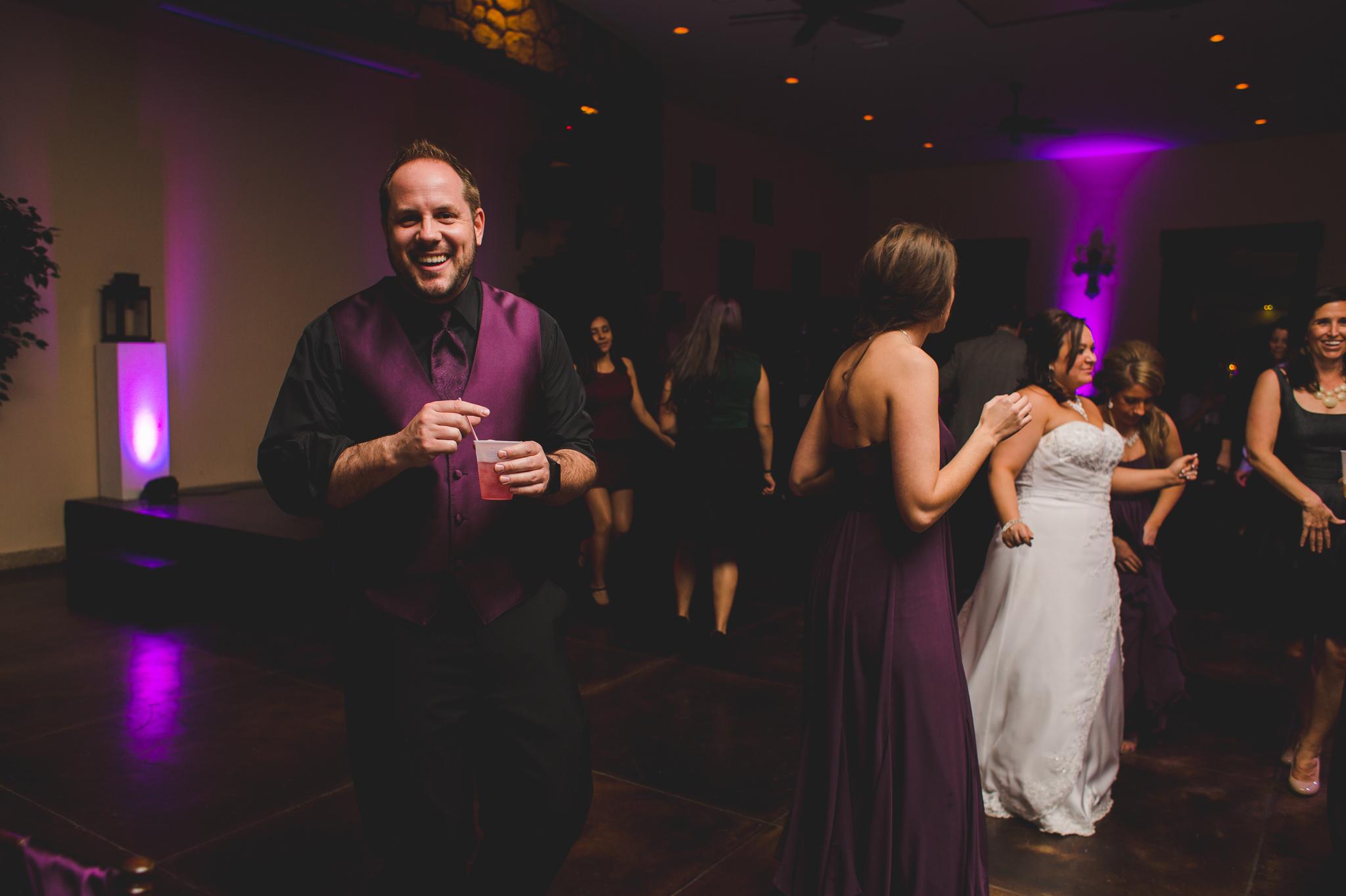 wedding guest groomsman laughs mj