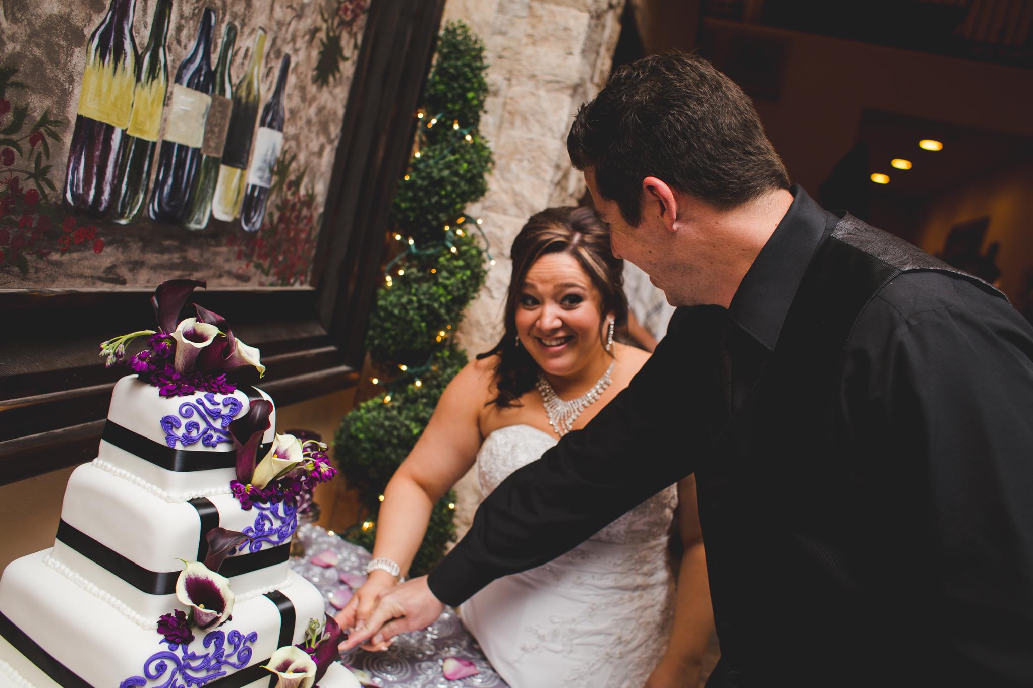 bride groom cutting cake