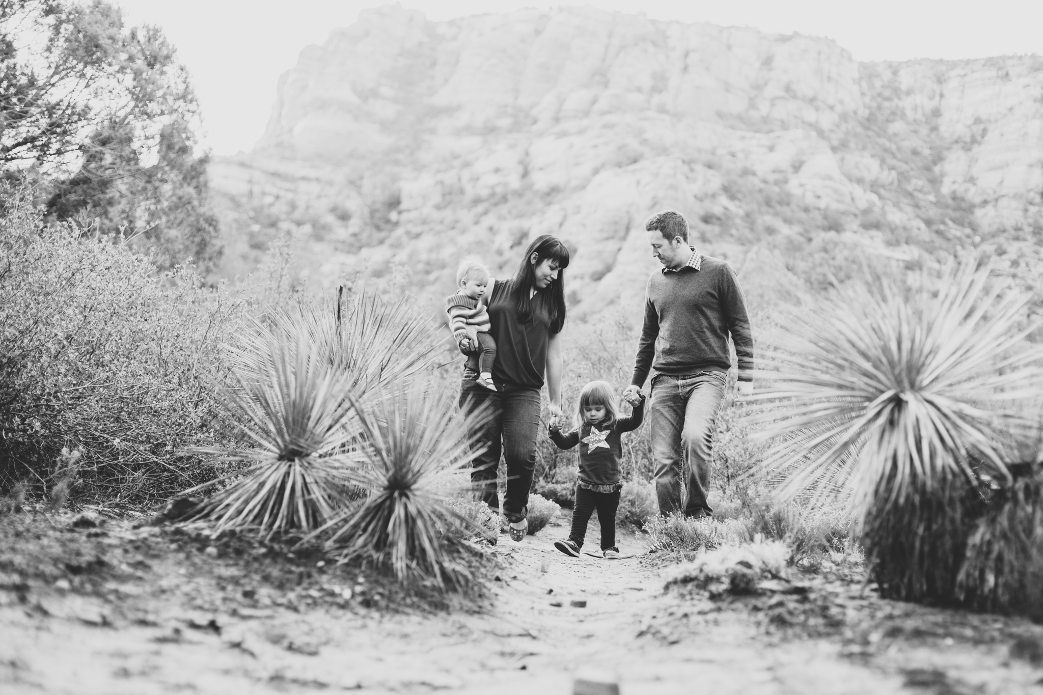 family walking in sedona black and white