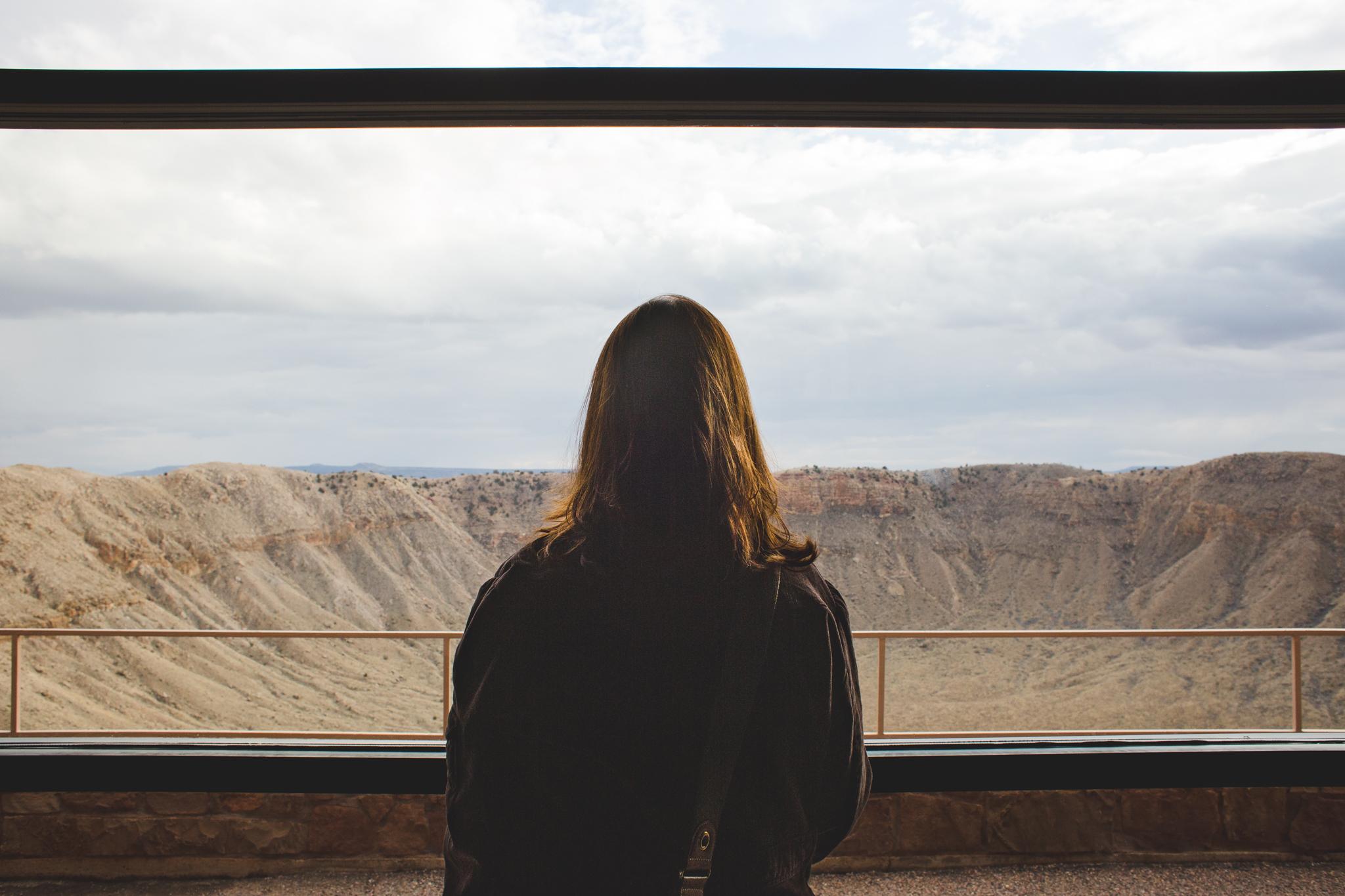 katie looking out window meteor crater