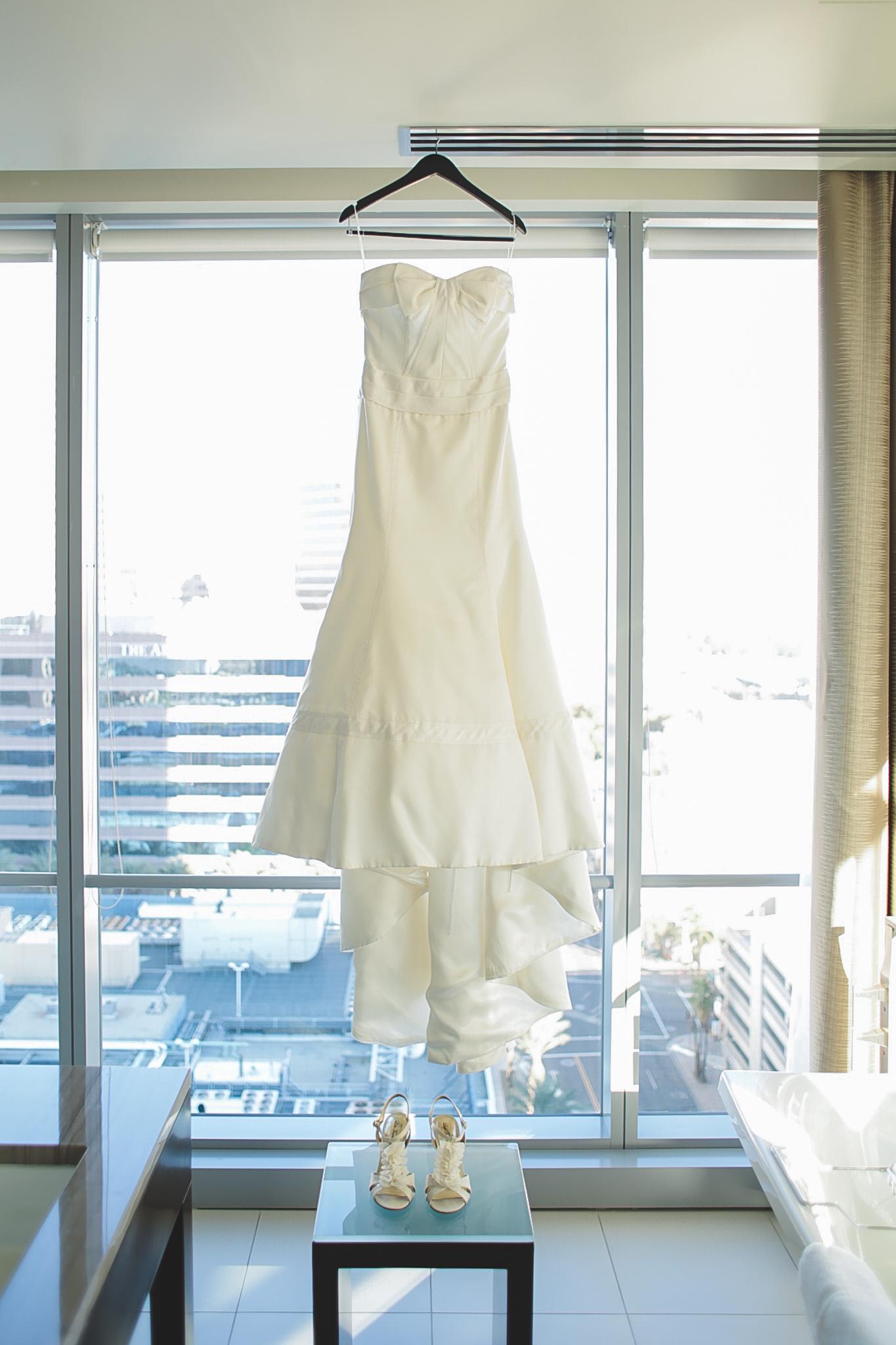 wedding dress hanging in suite phoenix