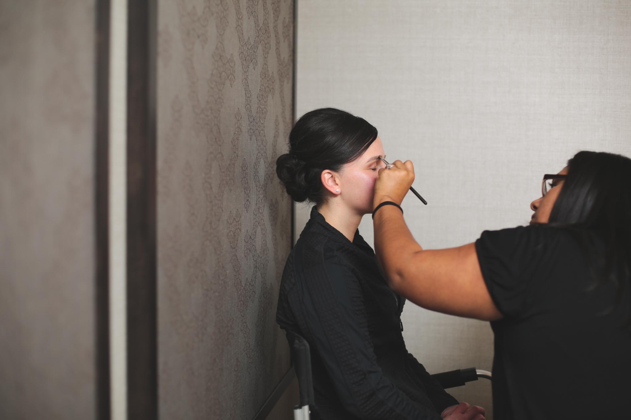 bride getting makeup applied hj