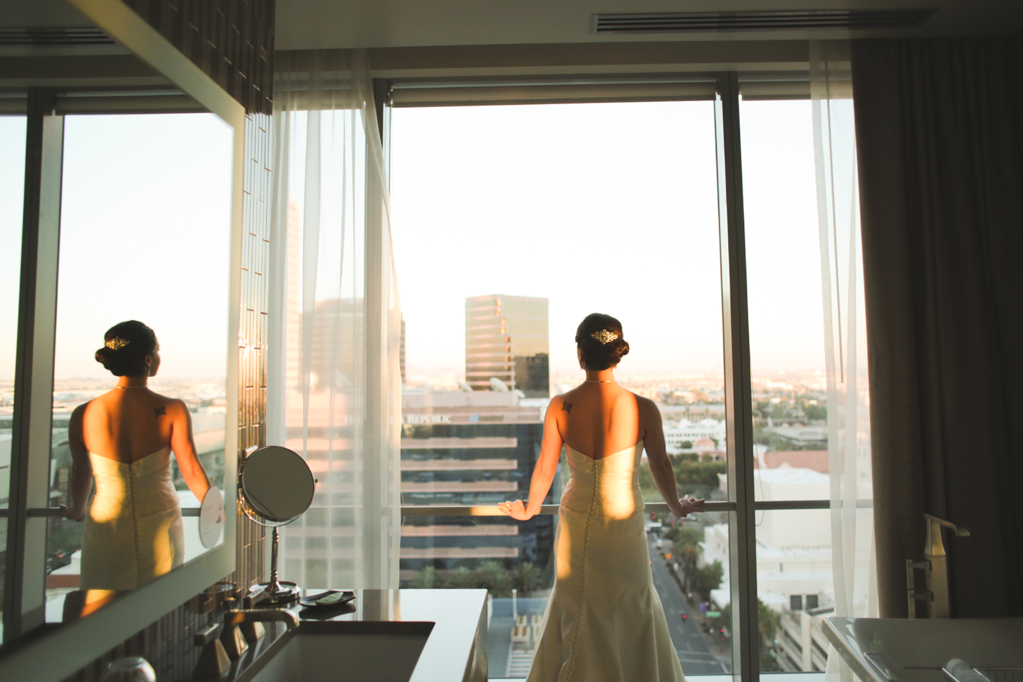 bride looks out from building at sunset downtown phoenix hj
