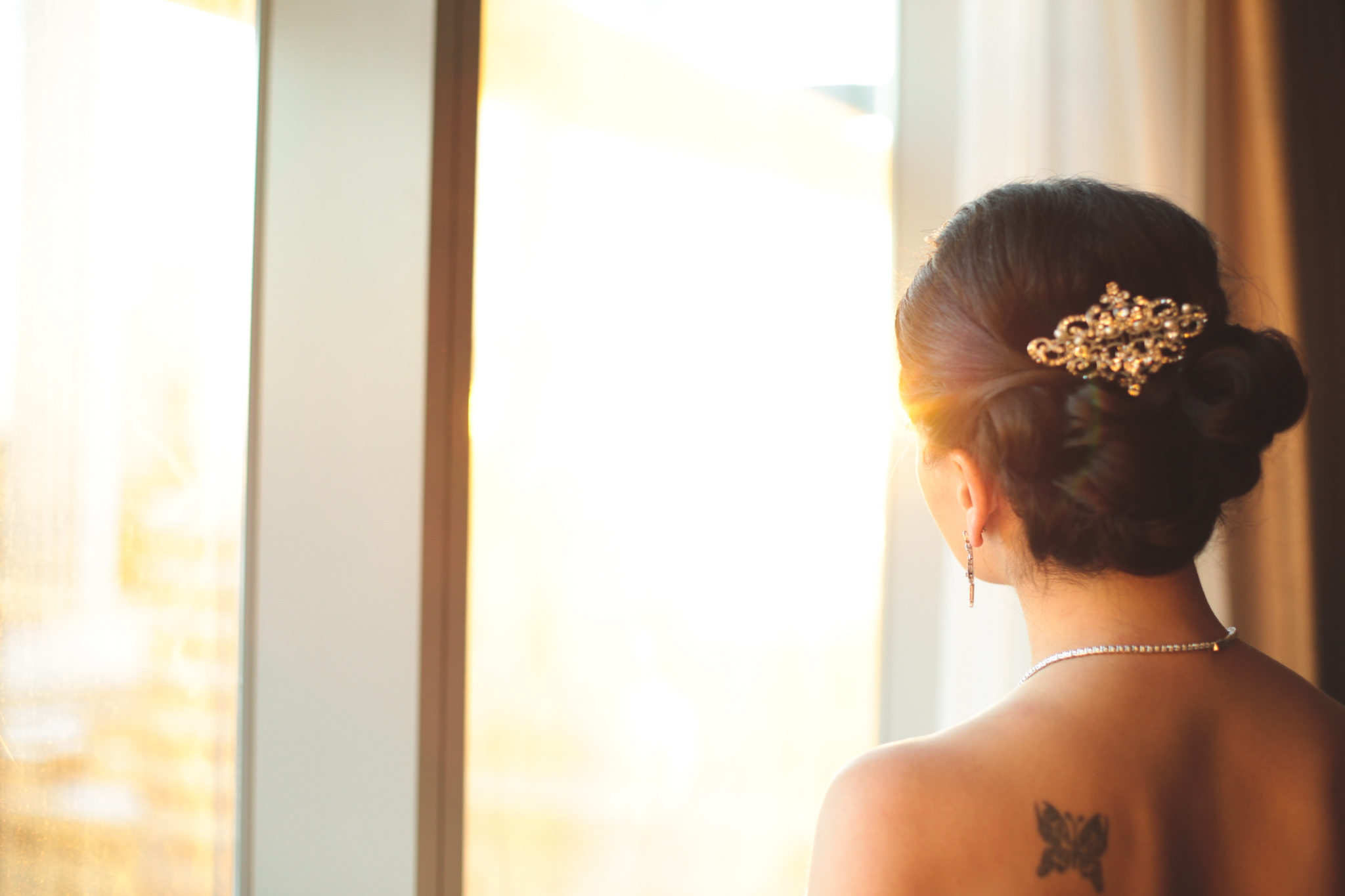 bride in the window at sunset hj