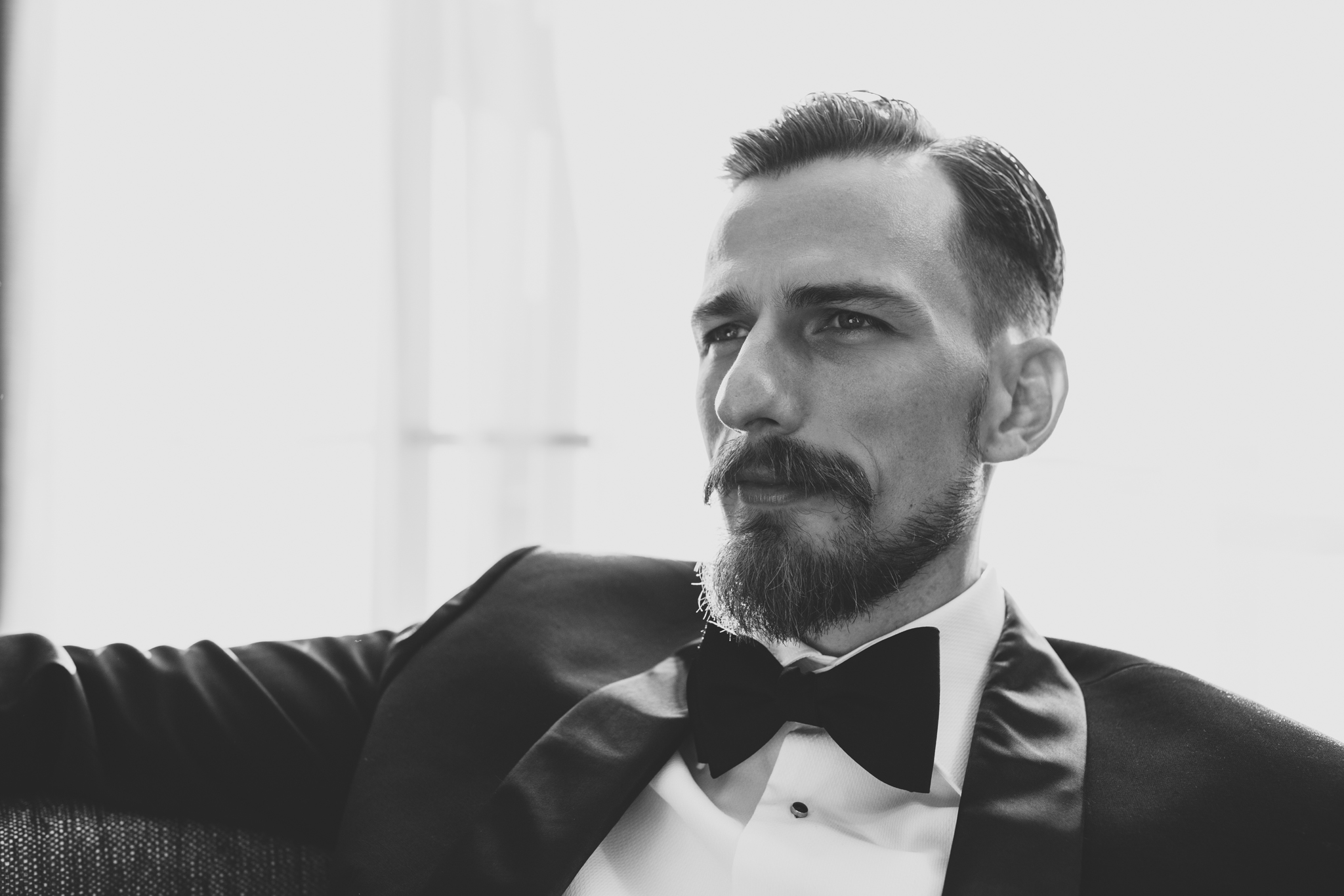 groom looks dapper in tux black and white hj