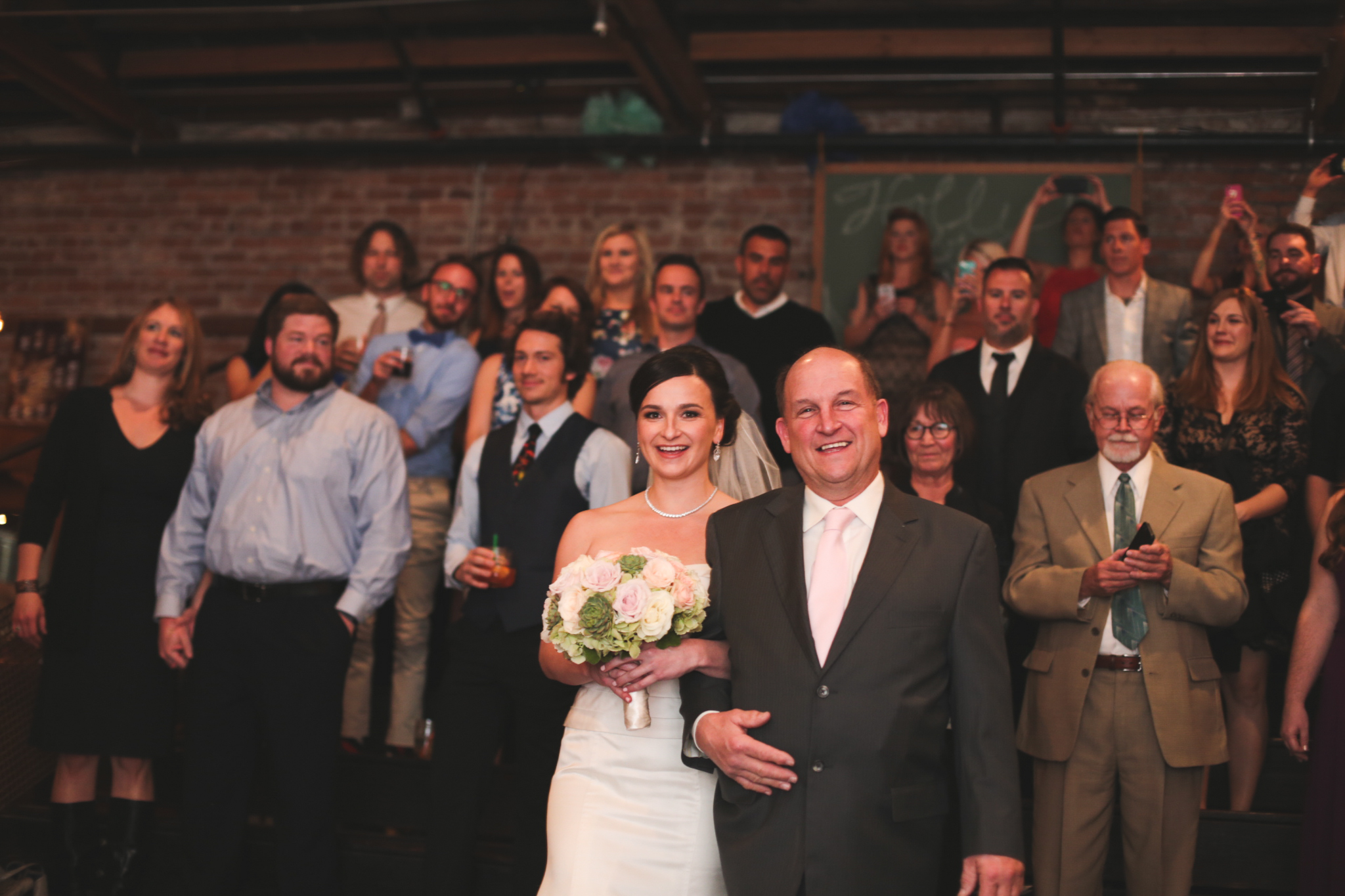 bride comes down aisle with dad hj