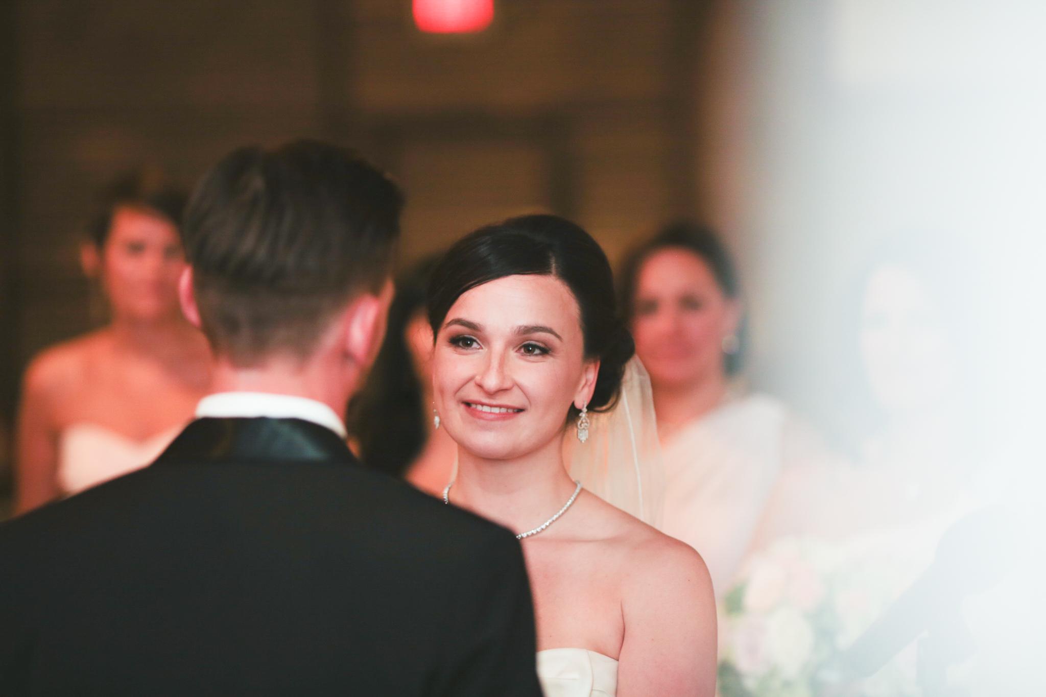 bride looks at groom ceremony hj