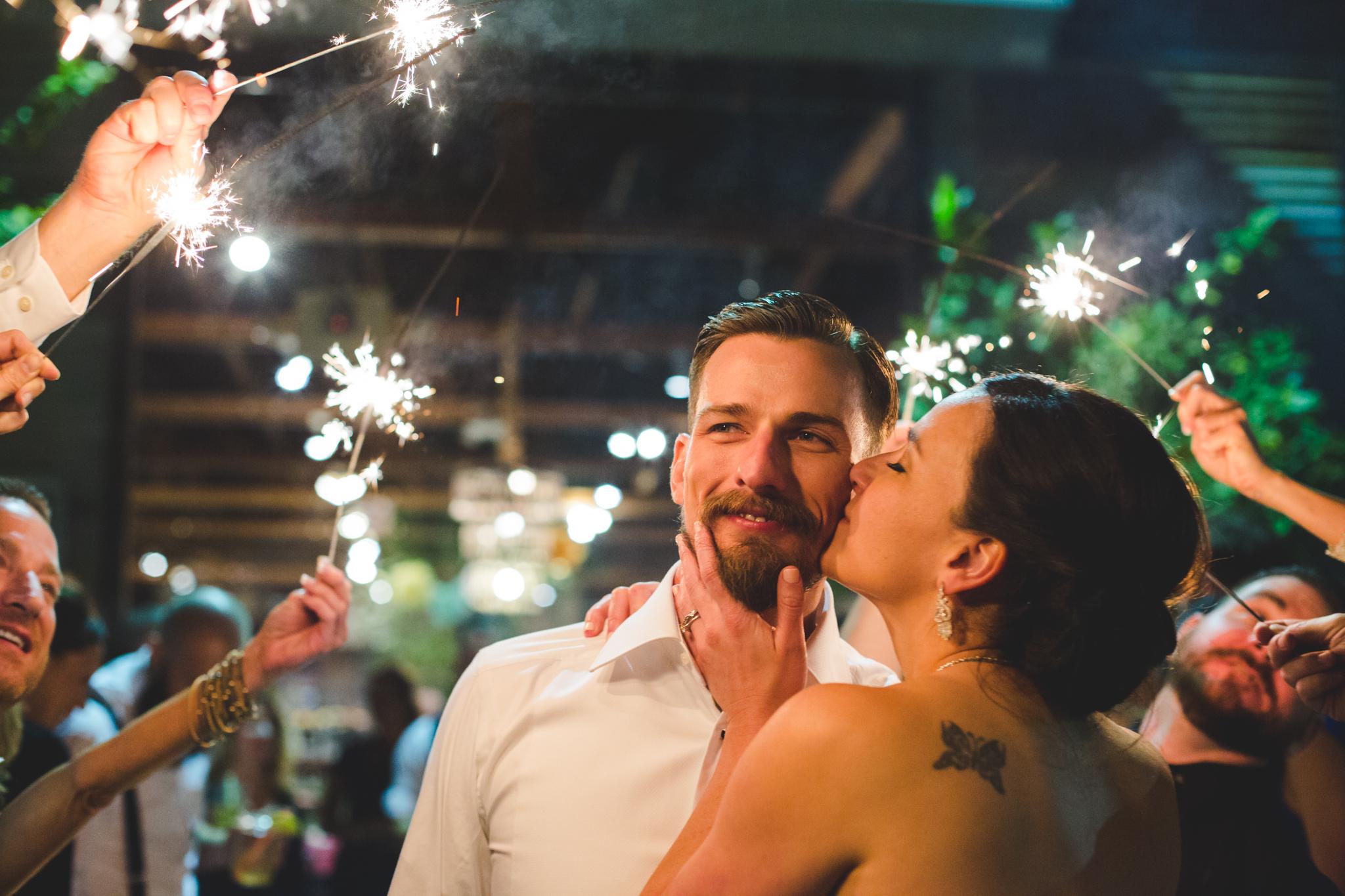 bride kisses groom romantic sparkler exit the duce hj