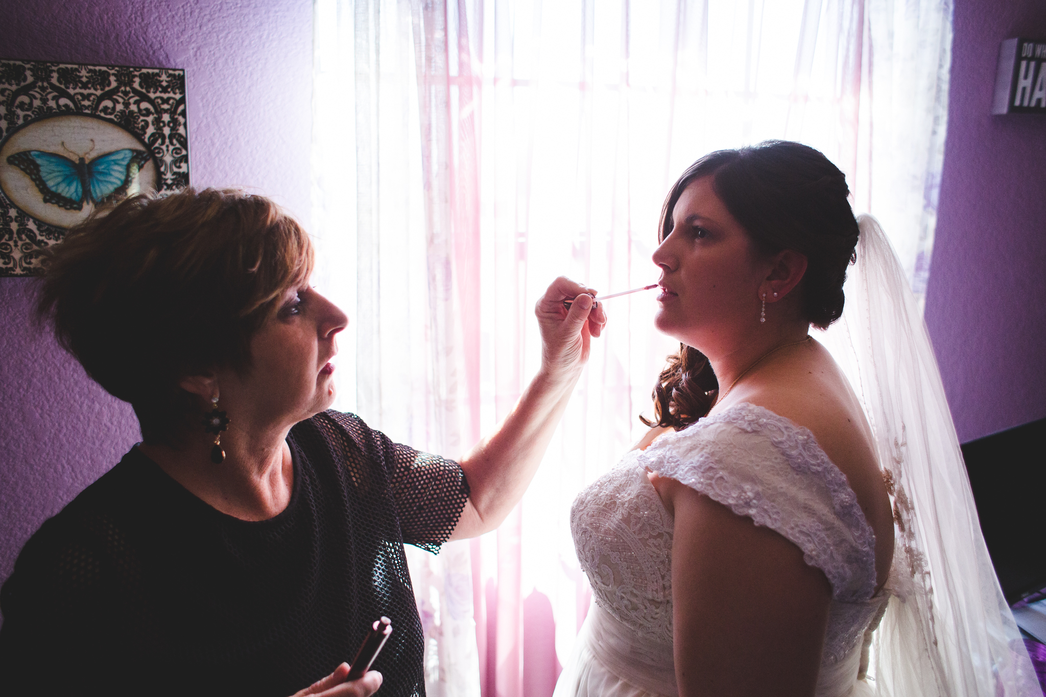 bride getting finishing touches put on sd