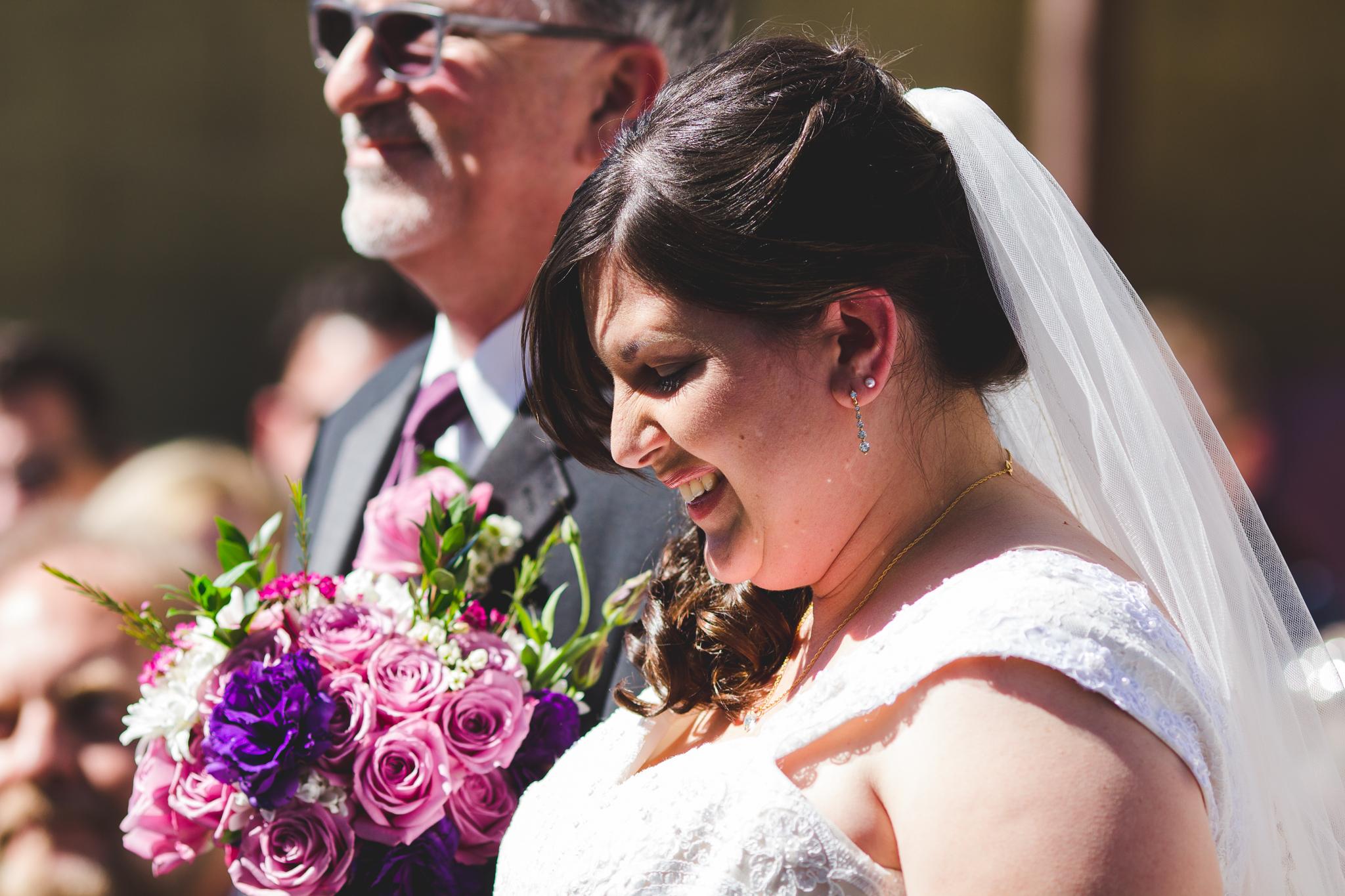 bride comes down aisle sd