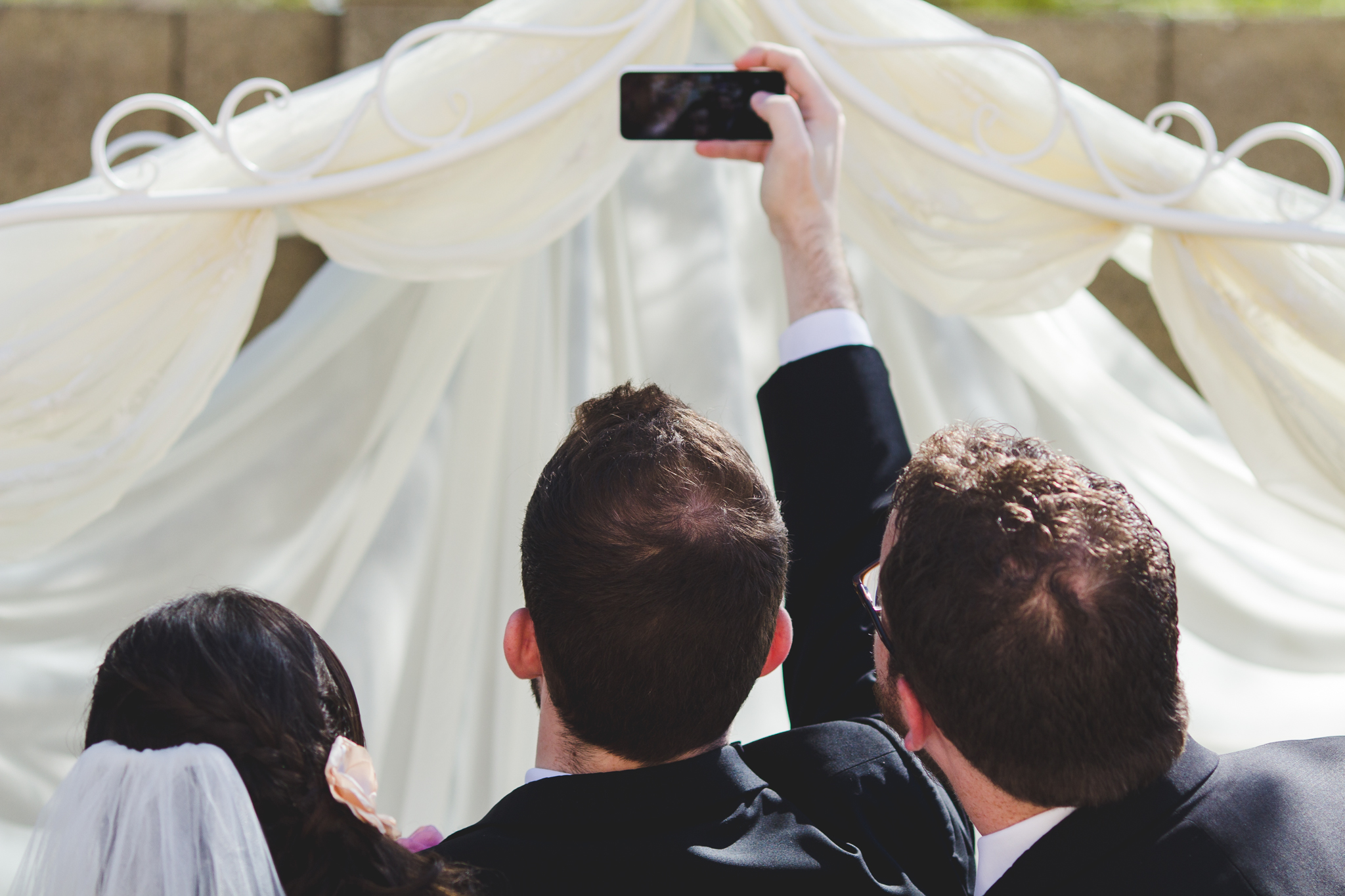 officiant snaps pic before proceeding sd