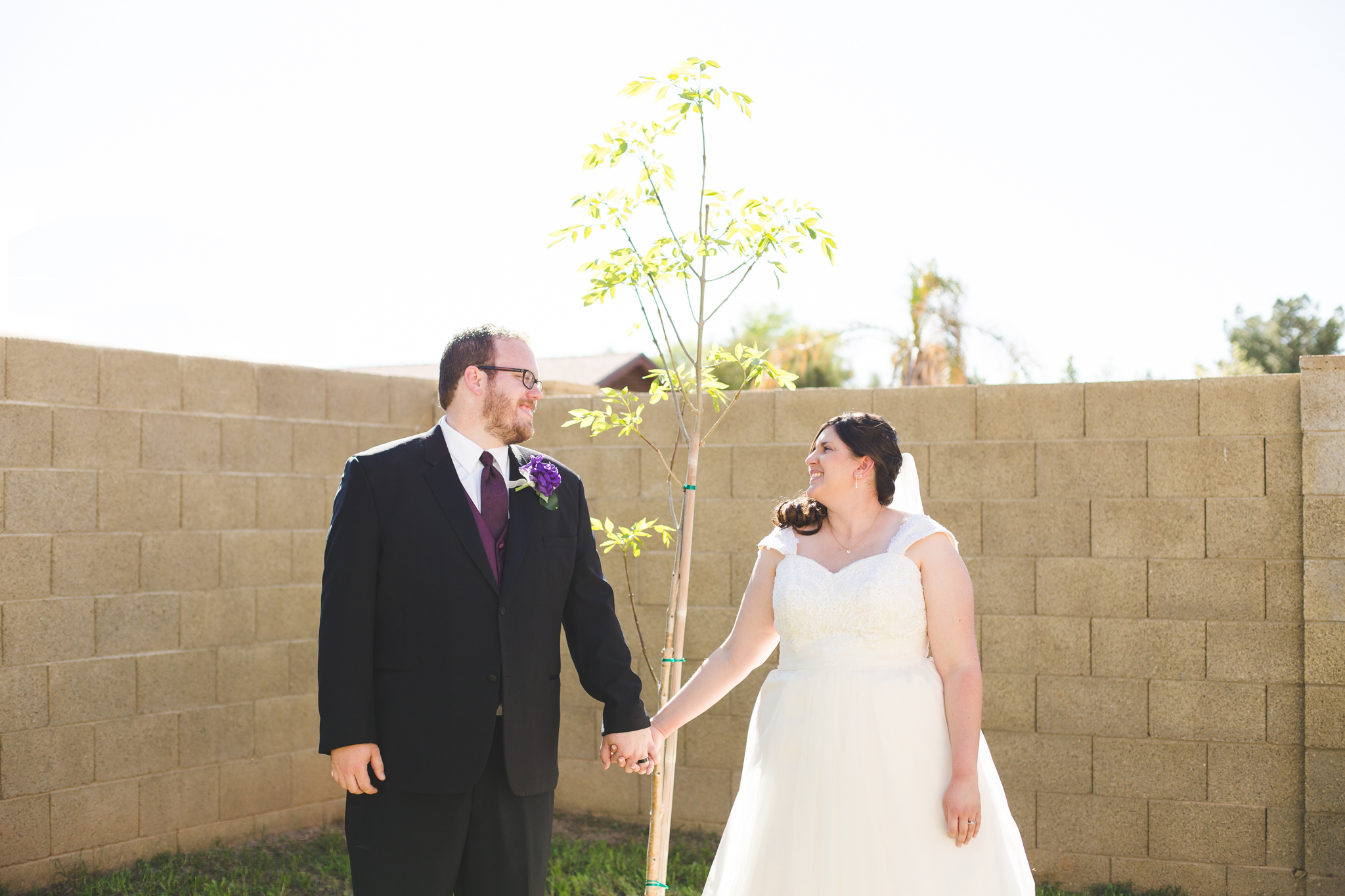 bride and groom and their young tree cool meaning sd
