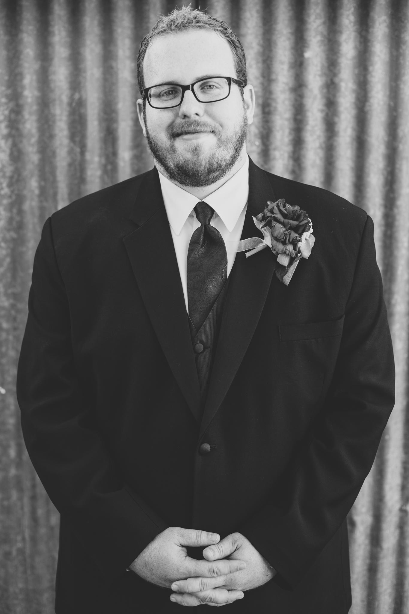 black and white groom portrait sd