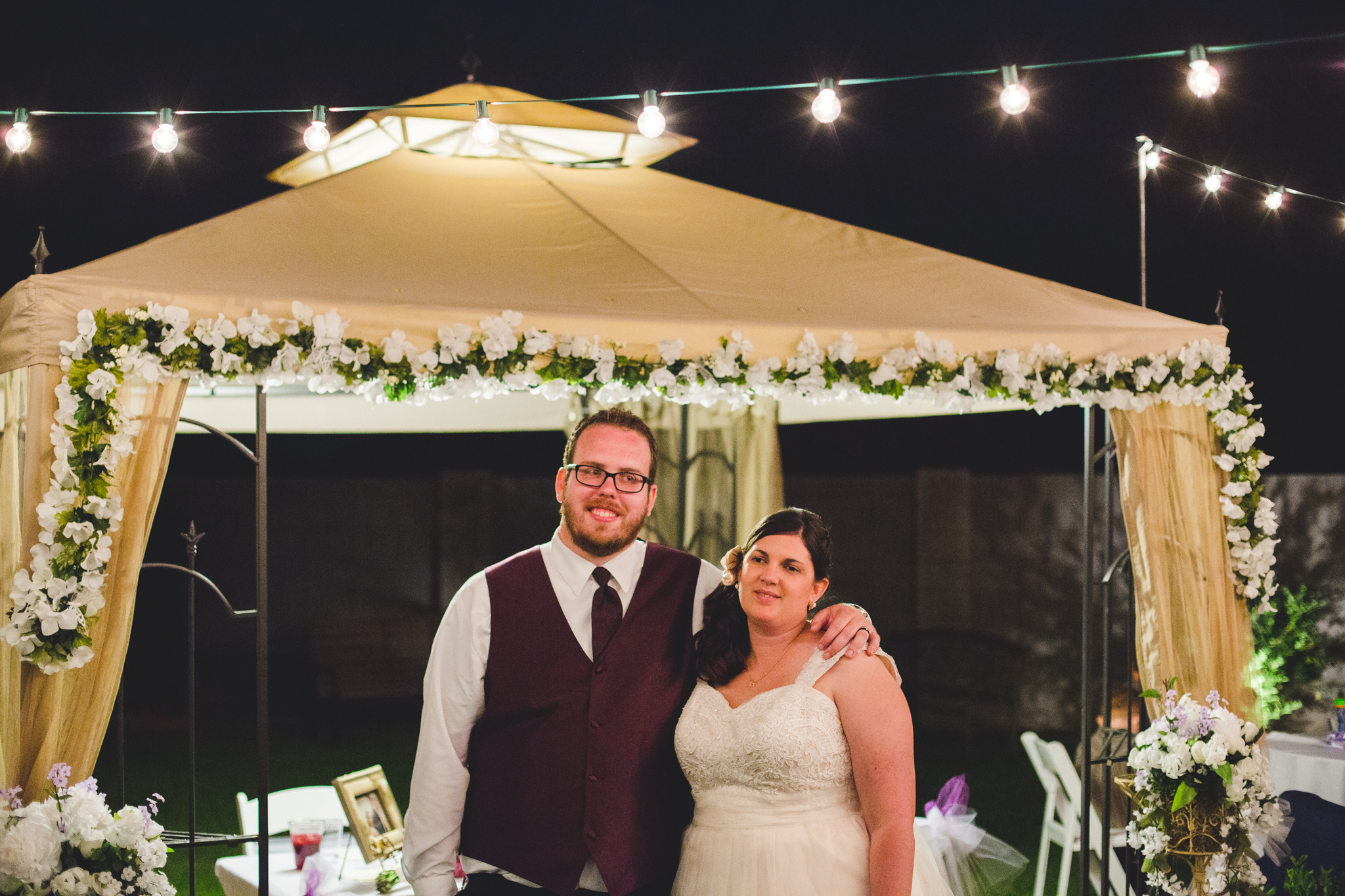 bride and groom smiling at reception sd