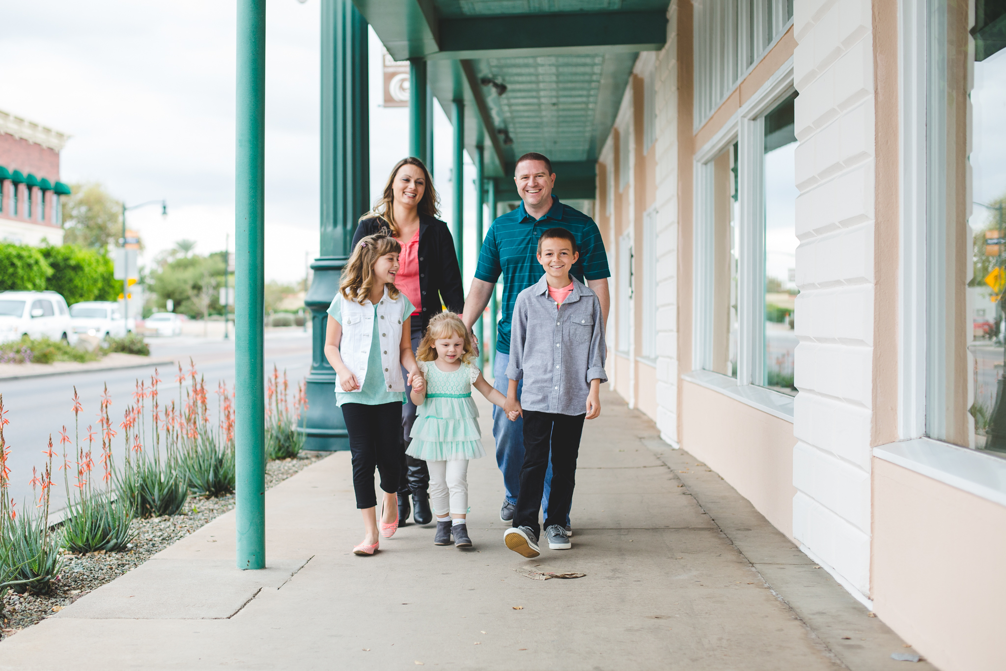 vote family walking down sidewalk
