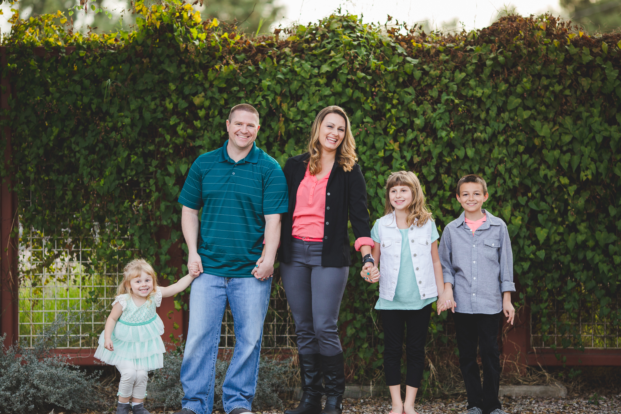 vote family shoot in downtown gilbert ivy wall