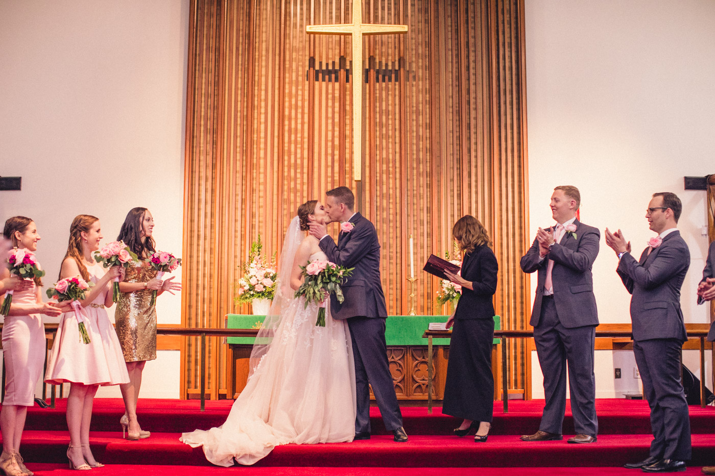 first-kiss-at-wedding-ceremony