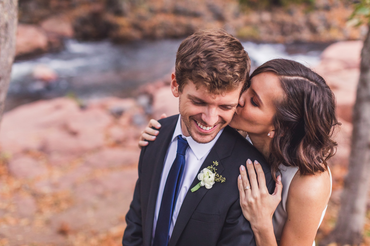 bride-cuddling-groom-with-kiss