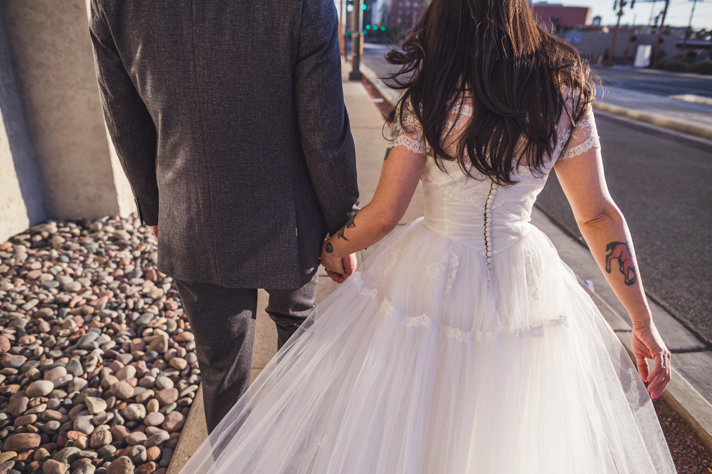bride-and-groom-hand-in-hand