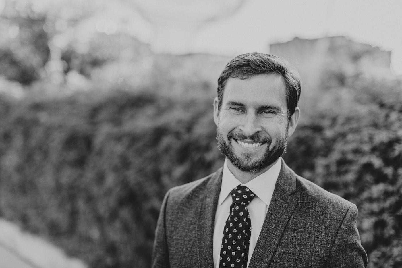 black-and-white-groom-smiling