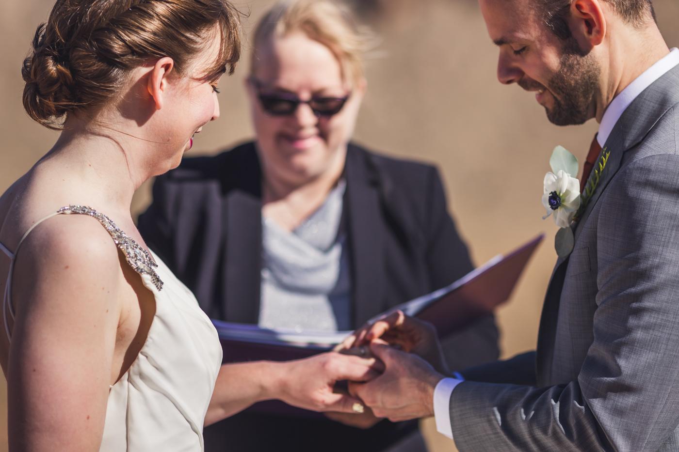 groom-putting-ring-on-bride