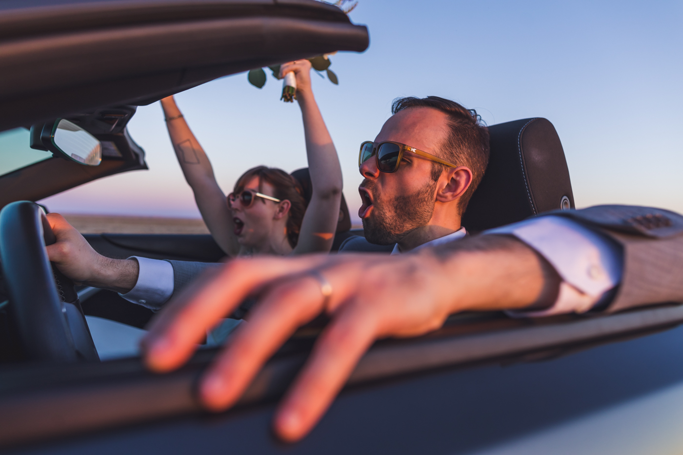 fun-bride-and-groom-riding-off-into-sunset
