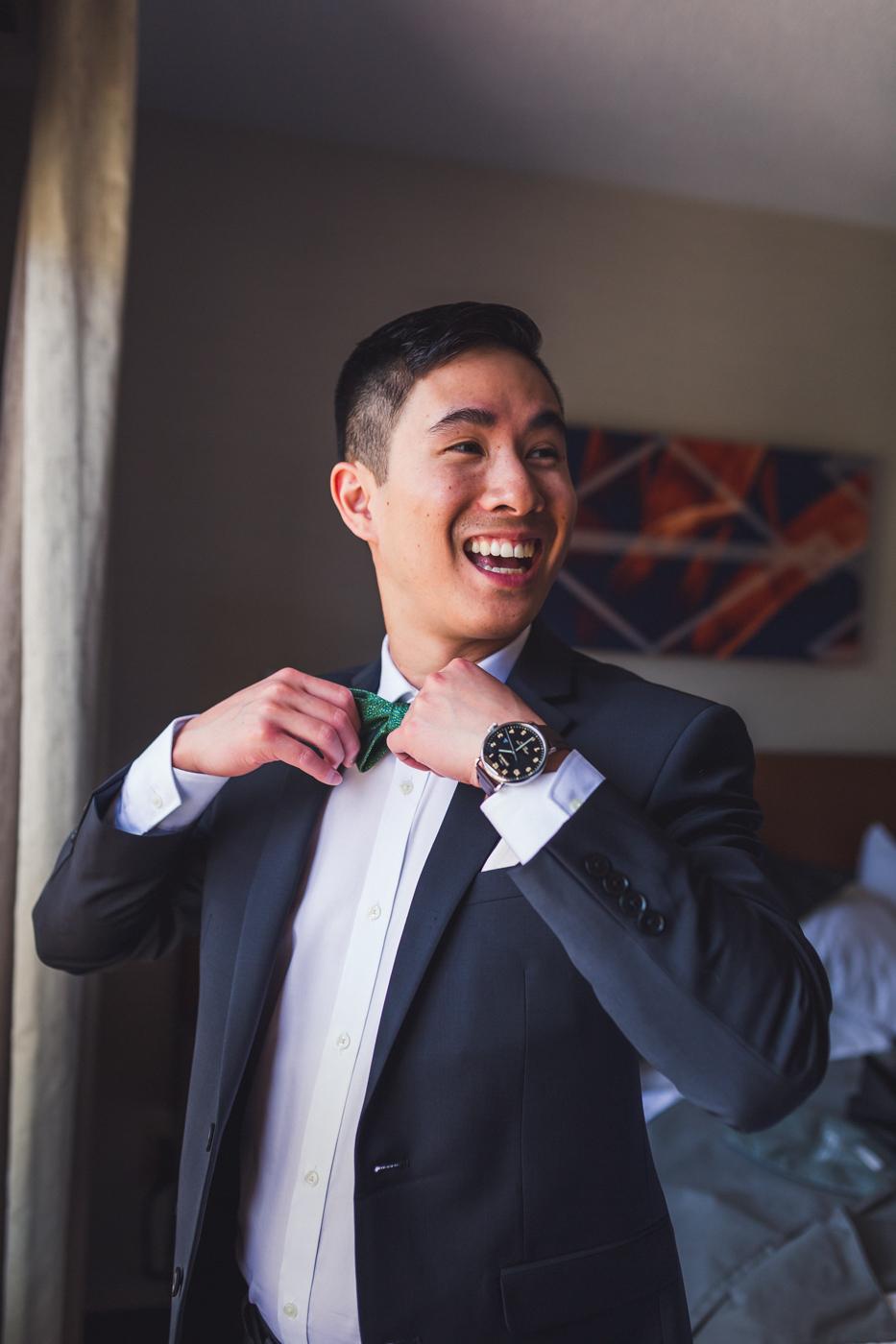 groom-adjusting-bow-tie