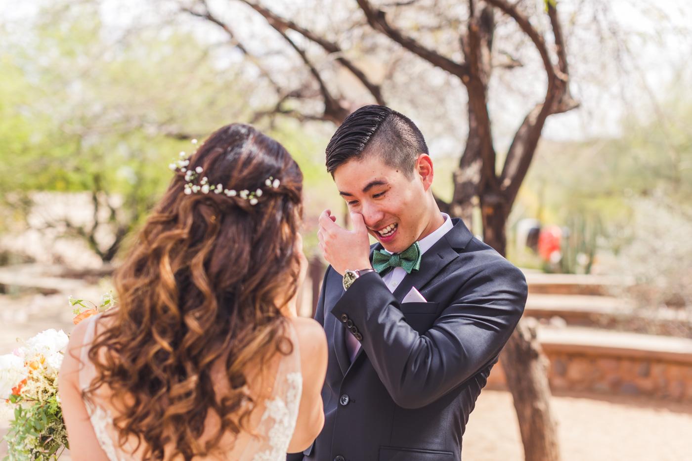 groom-tearing-up-seeing-bride