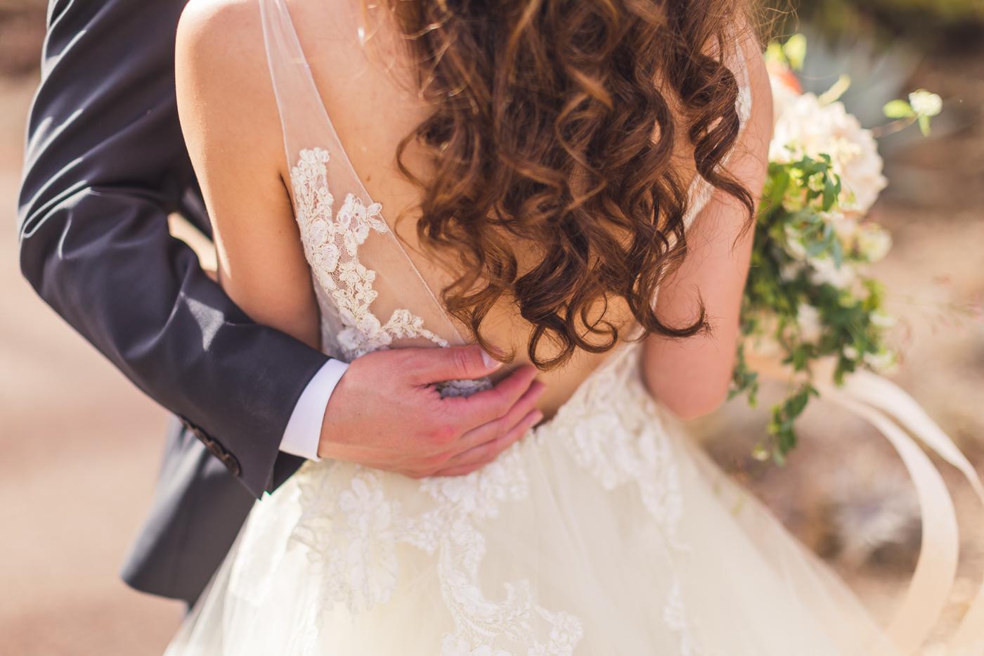 groom-holding-bride-detail