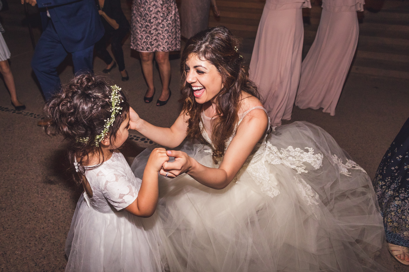 bride-having-fun-with-flower-girl