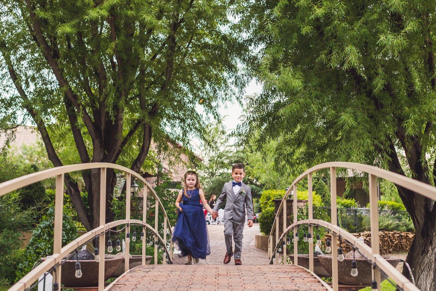 children-of-couple-walk-to-wedding-ceremony