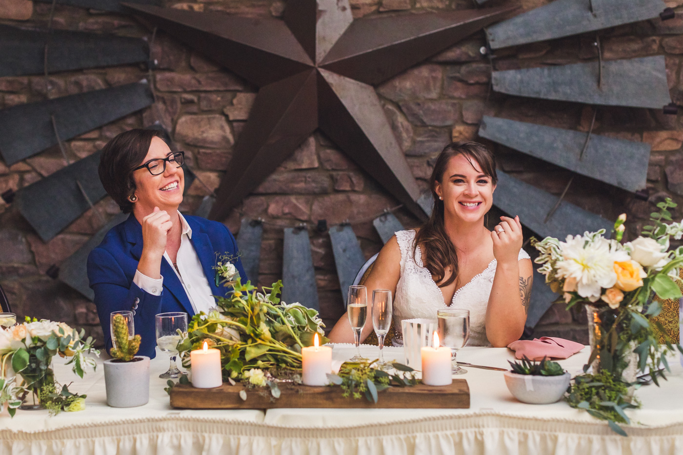 brides-laughing-at-wedding-toast