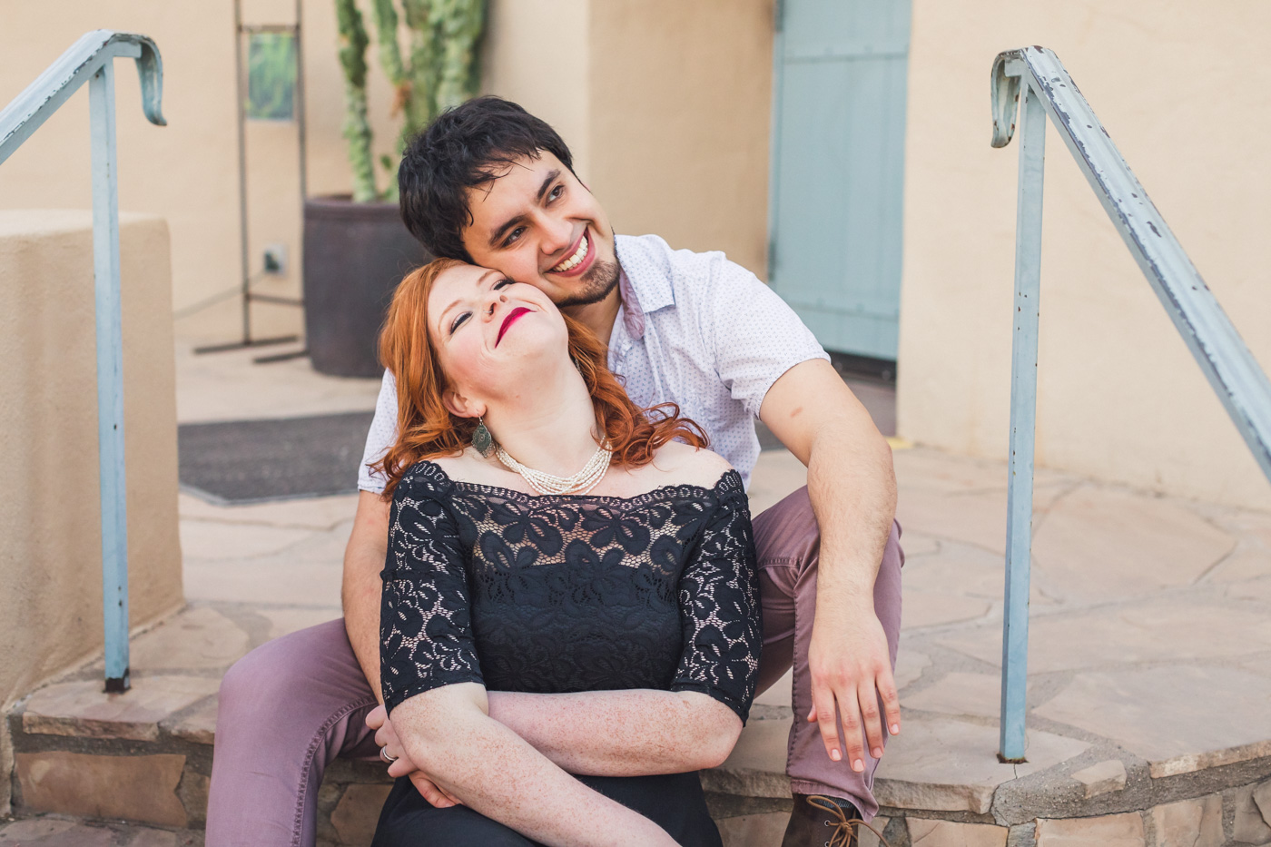 couple-cuddling-for-engagement-photo