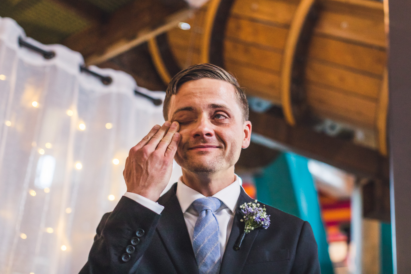 groom-getting-teary-at-wedding-ceremony
