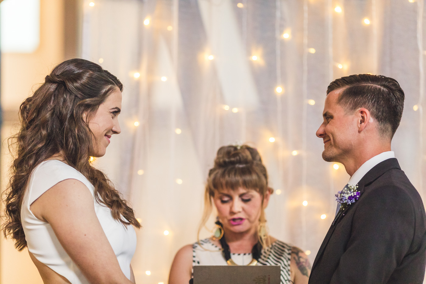 bride-and-groom-smiling-at-wedding-ceremony