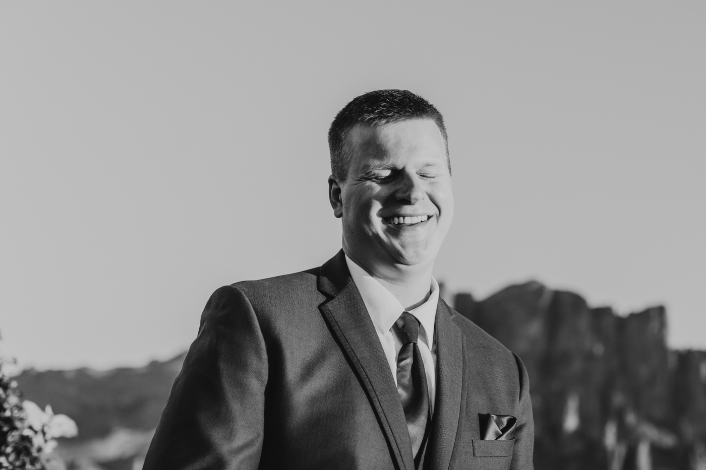 groom-laughing-during-ceremony