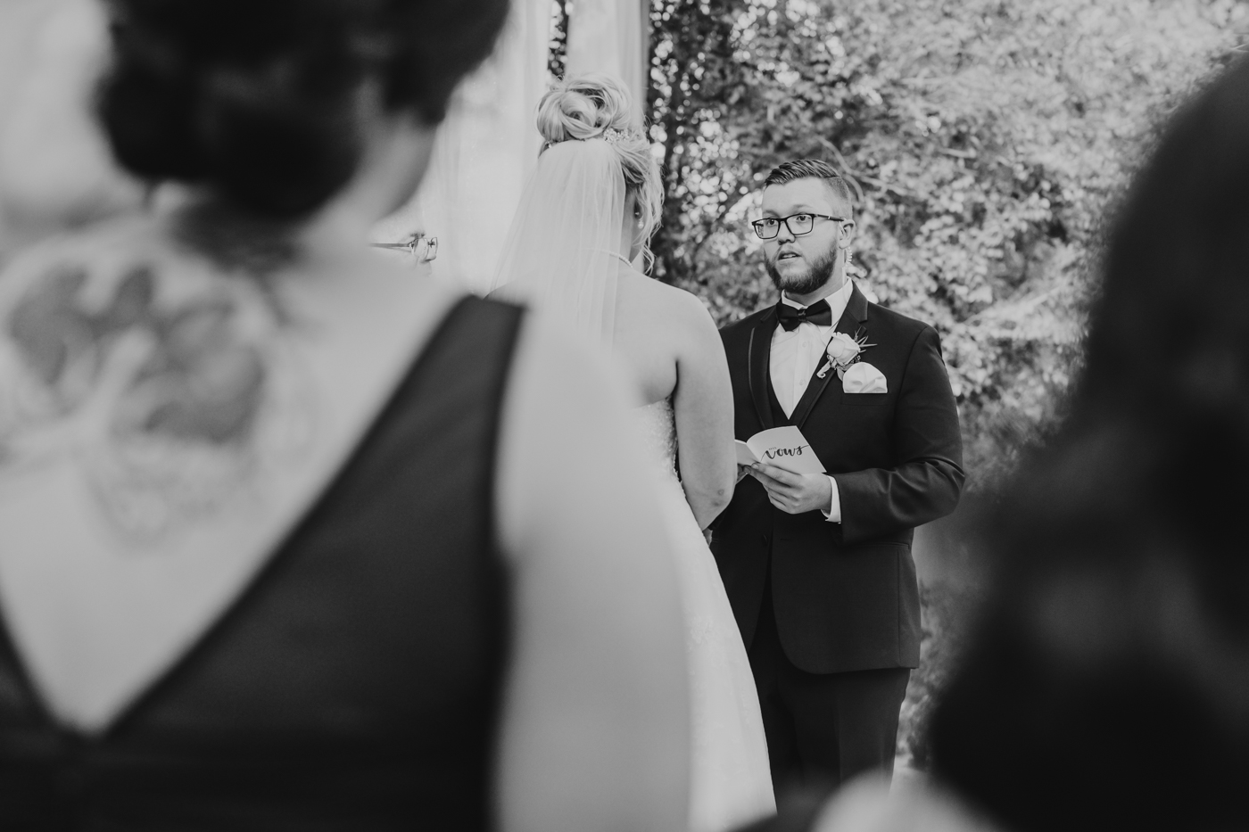 groom-reading-vows-at-wedding-ceremony
