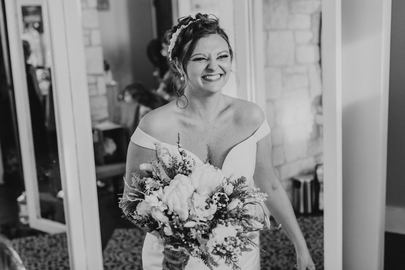bride-smiles-in-her-wedding-dress