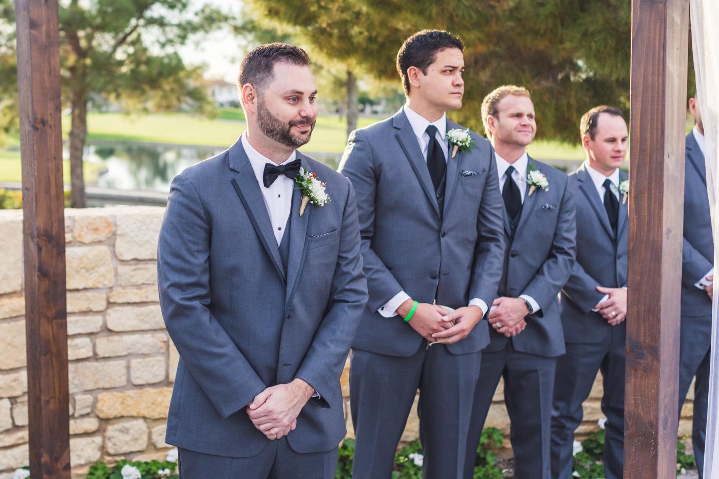 teary-groom-sees-bride-coming-down-aisle