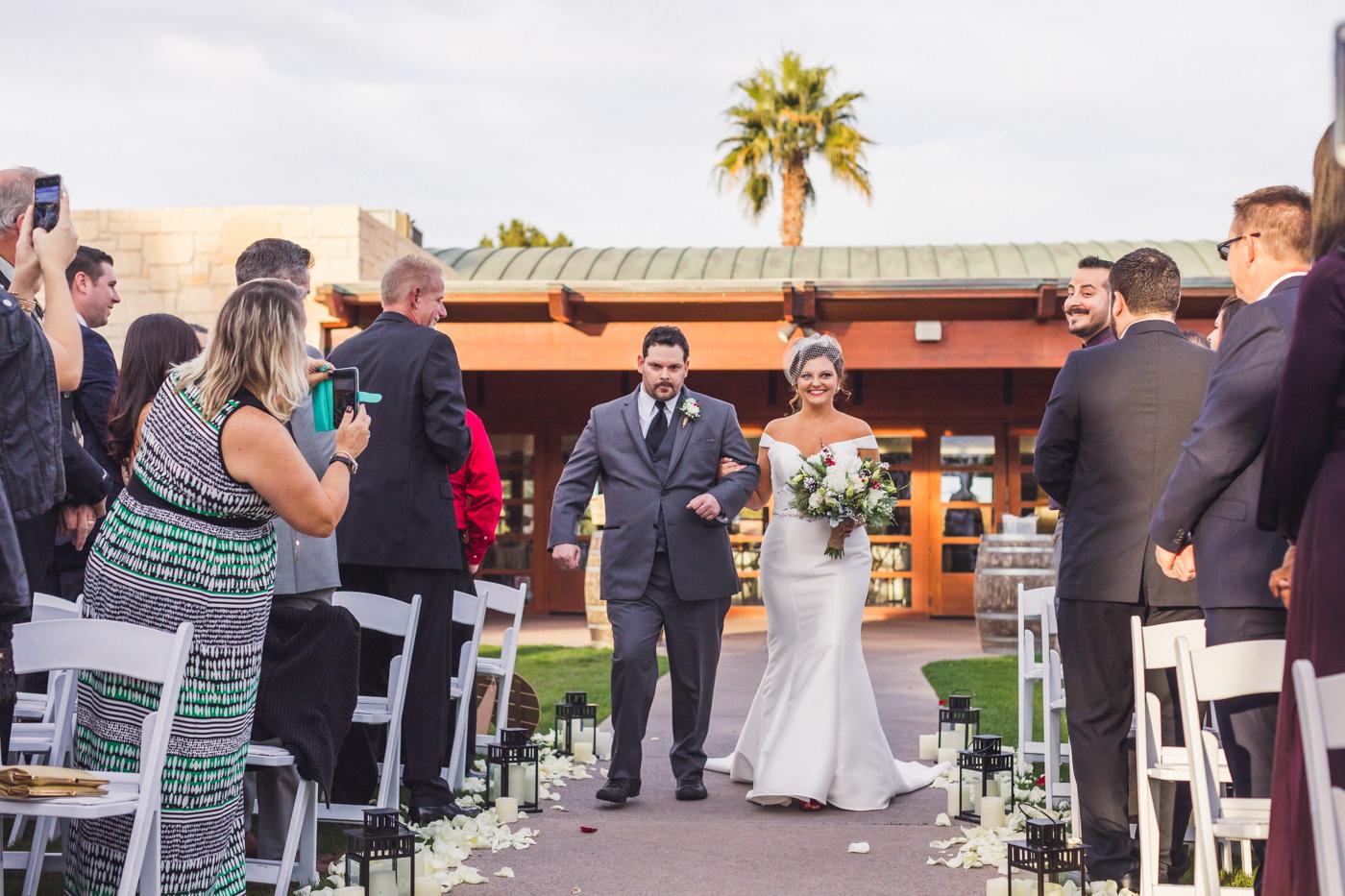 bride-walks-down-aisle-wedgewood-ocotillo-wedding