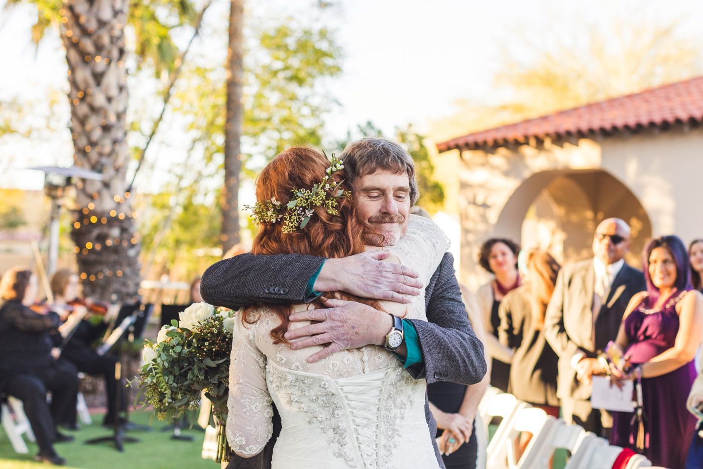 father-of-bride-hugging-daughter-wedding-ceremony