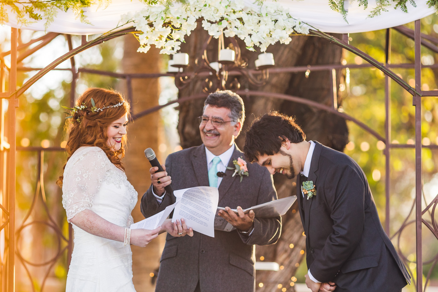 bride-and-groom-laughing-during-ceremony