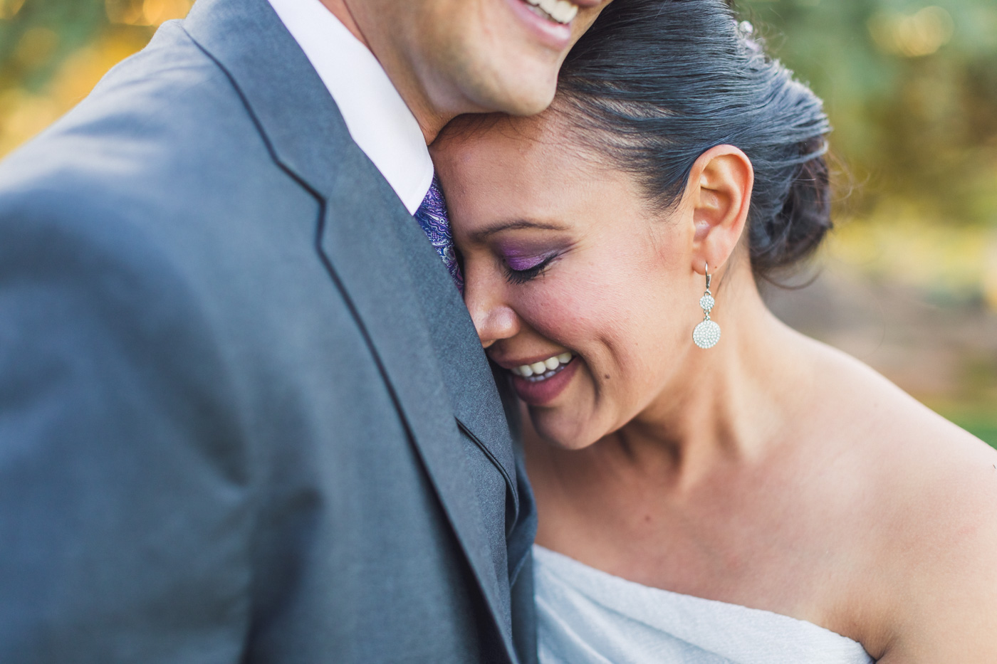 smiling-bride-cuddles-with-groom