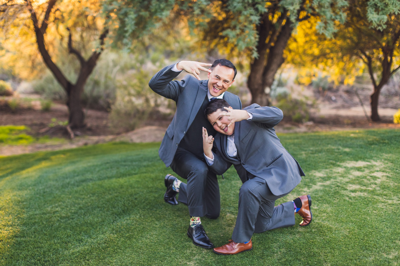 groom-and-son-have-fun-posing