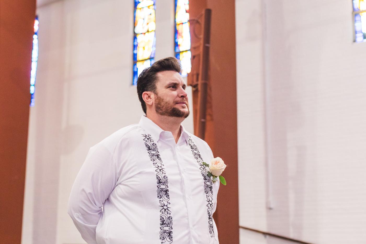 groom-watches-bride