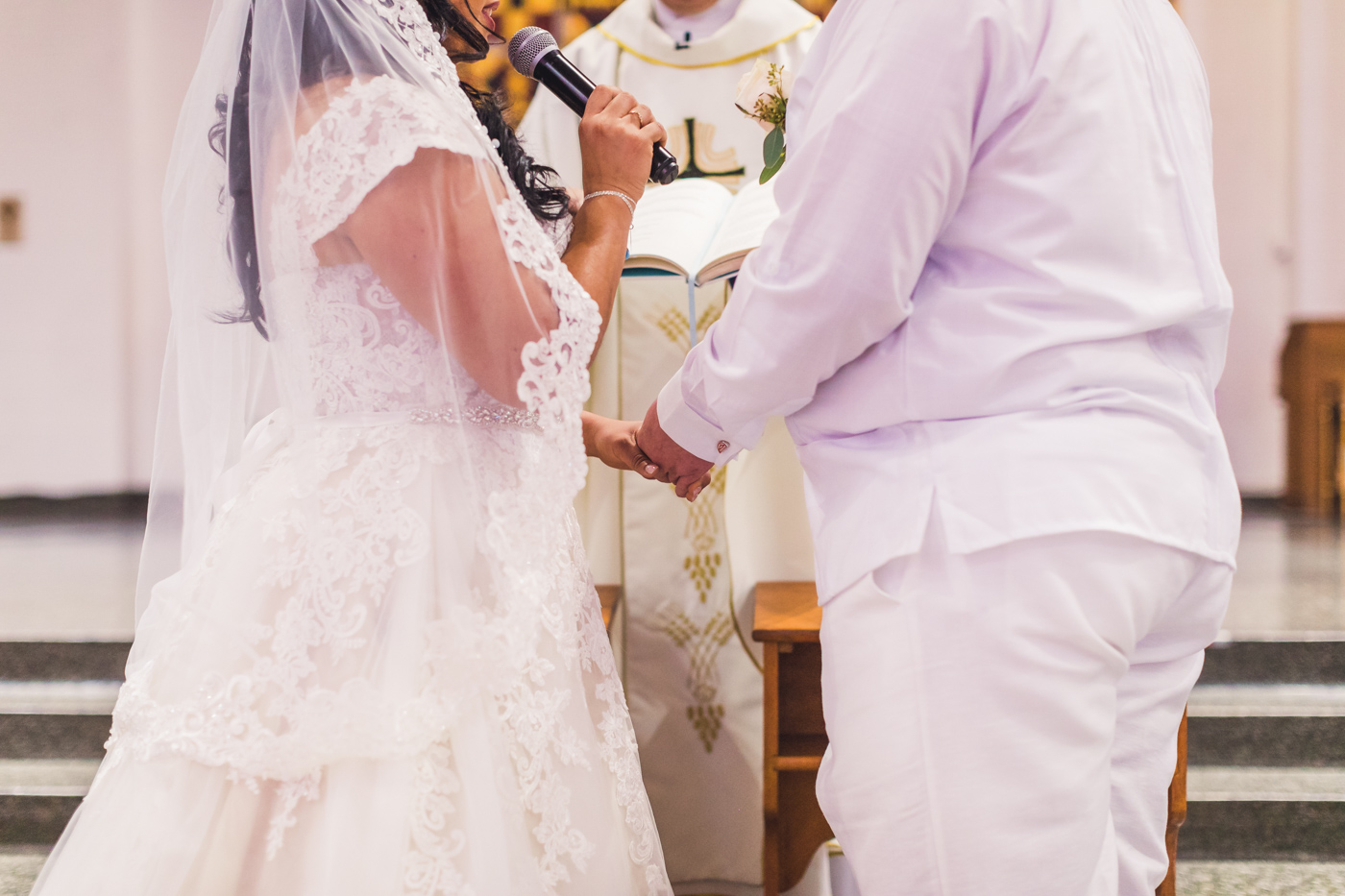 bride-and-groom-hold-hands-at-ceremony