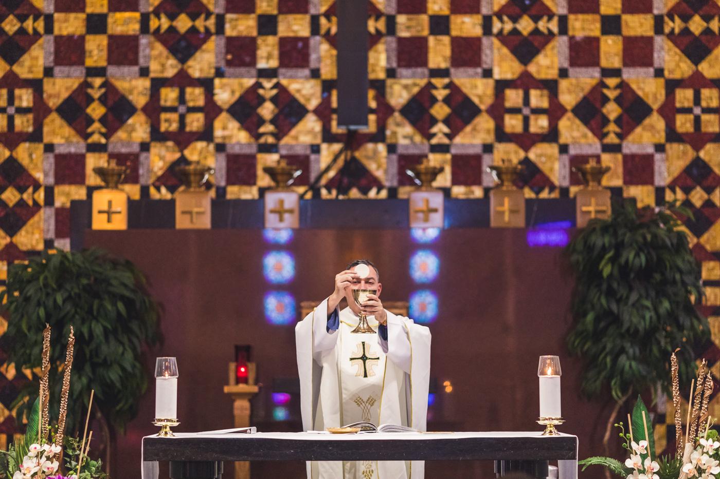 priest-blesses-eucharist
