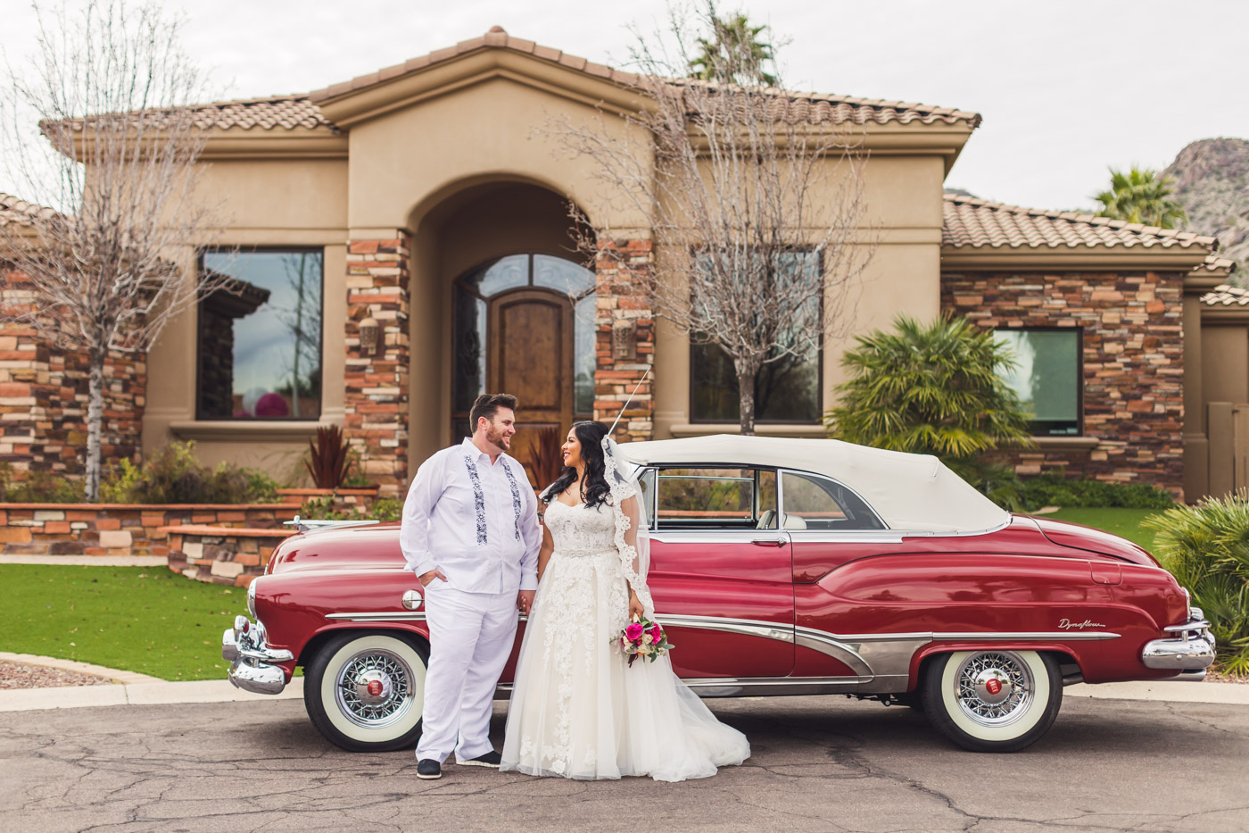 bride-and-groom-in-front-of-classic-car